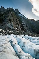 Looking across blue crevasses towards Defiance Ridge on Franz Josef Glacier when sun sets, Westland National Park, West Coast, World Heritage, South Island, New Zealand