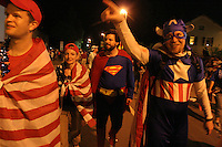 USA fan Greg Nelson of Oakland, CA, dressed as Captian America, points to some other fans cheering outside the stadium after the USA's FIFA World Cup match against Italy on Saturday June 17th, 2006 in Kaiserslautern, Germany.  The USA and Italy tied 1-1.