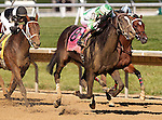 July 5, 2014: Fortune Pearl (#8), Trevor McCarthy up, reaches the front of the pack in the final furlong to win the Grade II Delaware Oalks, one and 1/16 miles, at Delaware Park in Stanton Delaware. She trained by Graham Motion and owned by Lawrence Stable Inc. #4 Joint Return (left), ridden by Kendrick Carmouche and trained by John Servis, finished second. @ Joan Fairman Kanes/ESW/CSM
