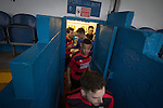 Port Talbot Town 3 Caerau Ely 0, 06/02/2016. Genquip Stadium, Welsh Cup fourth round. The players crowd out of the dressing rooms before Port Talbot Town played host to Caerau Ely (in red) in a Welsh Cup fourth round tie at the Genquip Stadium, formerly known as Victoria Road. Formed by exiled Scots in 1901 as Port Talbot Athletic, they competed in local and regional football before being promoted to the League of Wales  in 2000 and changing their name to the current version a year later. Town won this tie 3-0 against their opponents from the Welsh League, one level below the welsh Premier League where Port Talbot competed, watched by a crowd of 113. Photo by Colin McPherson.
