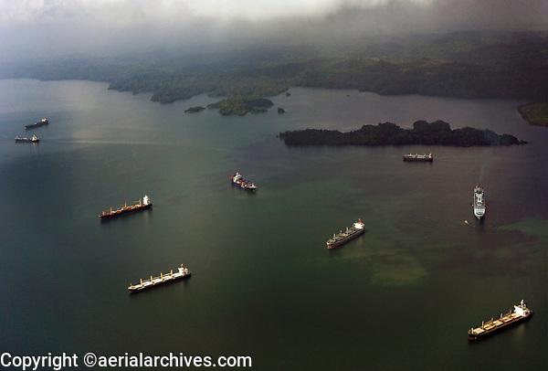 aerial photograph numerous ships waiting to transit the Panama Canal in Gatun Lake, Panama | fotografía aérea de numerosos barcos que esperan transitar por el Canal de Panamá en el Lago Gatún