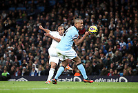 Barclays Premier League, Man City (blue) V Swansea City (white) Etihad Stadium, 27/10812<br /> Pictured: Routledge fires a shot past Kompany<br /> Picture by: Ben Wyeth / Athena Picture Agency