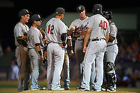 New Britain Rock Cats pitching coach Dave Burba (40) talks with pitcher Austin House (15) as Pat Valaika (12), Zach Osborne (4), Jordan Patterson (left), Joey Wong (back) and catcher Jan Vazquez listen in during a game against the Reading Fightin Phils on August 7, 2015 at FirstEnergy Stadium in Reading, Pennsylvania.  Reading defeated New Britain 4-3 in ten innings.  (Mike Janes/Four Seam Images)