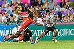 Jerry Tuwai of Fiji (C) runs with the ball during the HSBC Hong Kong Sevens 2018 match between Fiji and Kenya on 08 April 2018, in Hong Kong, Hong Kong. Photo by Marcio Rodrigo Machado / Power Sport Images