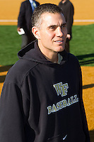 Wake Forest Demon Deacons head baseball coach Tom Walter is all smiles as he attends batting practice at Wake Forest Baseball Park on February 11, 2011 in Winston-Salem, North Carolina.  Just four days earlier Coach Walter donated one of his kidneys to Kevin Jordan, a freshman on the baseball team.  Photo by Brian Westerholt / Four Seam Images