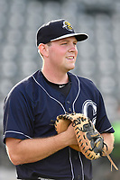 Catcher Ryan Lidge (21) of the Charleston RiverDogs warms up before a game against the Columbia Fireflies on Monday, August 7, 2017, at Spirit Communications Park in Columbia, South Carolina. Columbia won, 6-4. (Tom Priddy/Four Seam Images)