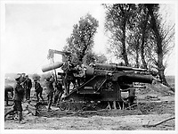 With the Canadians in the great battle<br /> Description<br /> <br /> Loading a heavy howitzer