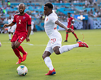 CHARLOTTE, NC - JUNE 23: Jonathan David #20 shoots on goal during a game between Cuba and Canada at Bank of America Stadium on June 23, 2019 in Charlotte, North Carolina.