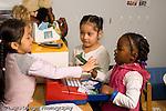 Preschool pretend play group of children playing store horizontal