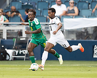 KANSAS CITY, KS - JUNE 26: Daniel Kadell #3 and Levi Garcia #11 go after the ball during a game between Guyana and Trinidad