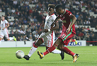 Jordan Ayew of Swansea City crosses the ball into Tammy Abraham of Swansea City to score Swanseas third goal of the match during the Carabao Cup Second Round match between MK Dons and Swansea City at StadiumMK, Milton Keynes, England, UK. 22 August 2017