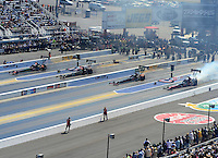 Apr. 14, 2012; Concord, NC, USA: NHRA top fuel dragster drivers (left to right) Terry McMillen ,Khalid Albalooshi , Doug Kalitta and David Grubnic race four wide during qualifying for the Four Wide Nationals at zMax Dragway. Mandatory Credit: Mark J. Rebilas-