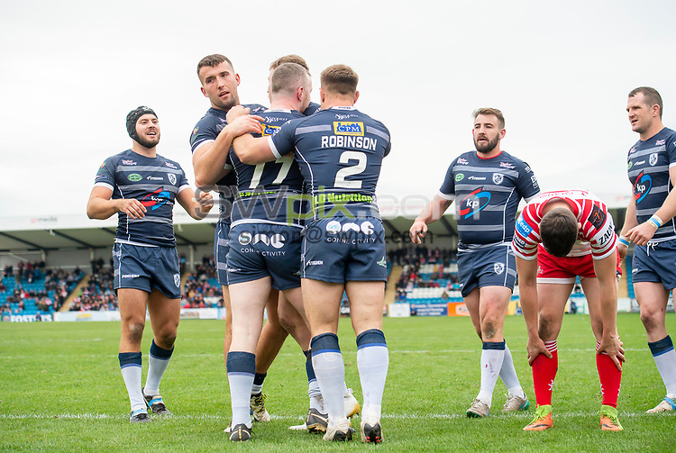 Picture by Allan McKenzie/SWpix.com - 07/10/2018 - Rugby League - Betfred Championship Shield Super 8's Final - Featherstone Rovers v Leigh Centurions - LD Nutrition Stadium, Featherstone, England - Featherstone's Connor Farrell is congratulated on scoring a try against Leigh.