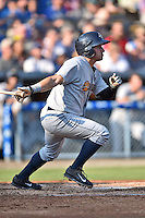 Charleston RiverDogs center fielder Mark Payton #6 swings at a pitch during a game against the Asheville Tourists at McCormick Field July 26, 2014 in Asheville, North Carolina. The RiverDogs defeated the Tourists 8-7. (Tony Farlow/Four Seam Images)