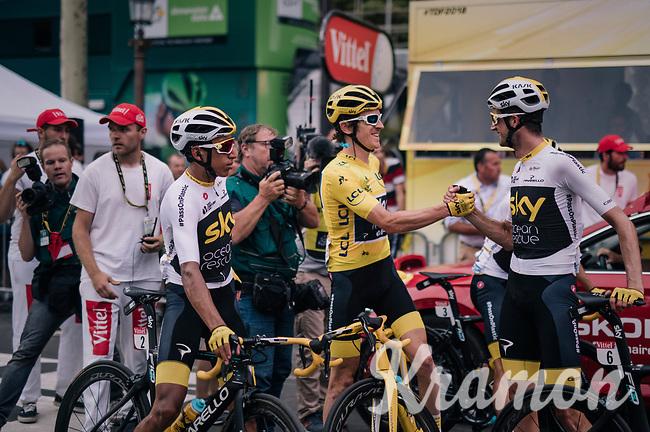 yellow jersey / GC leader Geraint Thomas (GBR/SKY) congratulated by teammates Wout Poels (NED/SKY) & Egan Bernal Gomez (COL/SKY) after finishing the Tour<br /> <br /> Stage 21: Houilles > Paris / Champs-Élysées (115km)<br /> <br /> 105th Tour de France 2018<br /> ©kramon