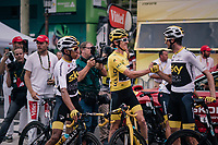 yellow jersey / GC leader Geraint Thomas (GBR/SKY) congratulated by teammates Wout Poels (NED/SKY) & Egan Bernal Gomez (COL/SKY) after finishing the Tour<br /> <br /> Stage 21: Houilles > Paris / Champs-Élysées (115km)<br /> <br /> 105th Tour de France 2018<br /> ©kramon