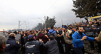 Pictured: Migrants clash with Greek police Monday 29 February 2016<br /> Re: A crowd of migrants has burst through a barbed-wire fence on the FYRO Macedonia-Greece border using a steel pole as a battering ram.<br /> TV footage showed migrants pushing against the fence at Idomeni, ripping away barbed wire, as FYRO Macedonian police let off tear gas to force them away.<br /> A section of fence was smashed open with the battering ram. It is not clear how many migrants got through.<br /> Many of those trying to reach northern Europe are Syrian and Iraqi refugees.<br /> About 6,500 people are stuck on the Greek side of the border, as FYRO Macedonia is letting very few in. Many have been camping in squalid conditions for a week or more, with little food or medical help.
