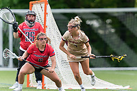 NEWTON, MA - MAY 14: Caitlynn Mossman #7 of Boston College on the attack as Keyla Bay #6 of Fairfield University defends during NCAA Division I Women's Lacrosse Tournament first round game between Fairfield University and Boston College at Newton Campus Lacrosse Field on May 14, 2021 in Newton, Massachusetts.