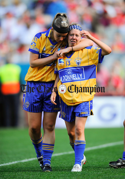 Clare's Lorraine Kelly consoles Aine Kelly following the loss to Tipperary in the Intermediate Ladies Football final at Croke Park. Photograph by John Kelly.