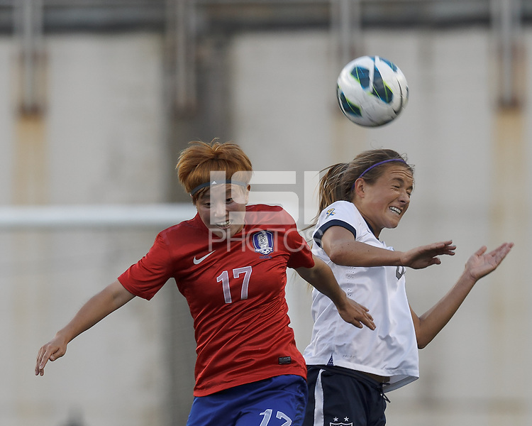 Korea Republic midfielder Park Heeyoung (17) and USWNT defender Kristie Mewis (8) battle for head ball.  In an international friendly, the U.S. Women's National Team (USWNT) (white/blue) defeated Korea Republic (South Korea) (red/blue), 4-1, at Gillette Stadium on June 15, 2013.