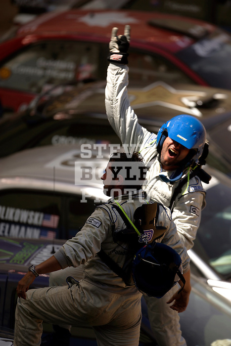 Driver Matt Iorio and co-driver Ole Holter celebrate their race after competing in the Rally Car Race finals during X-Games 12 in Los Angeles, California on August 5, 2006.