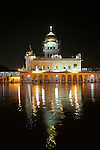 """June 21 2012, New Delhi, India: Gurudwara Bangla Sahib is the most prominent Sikh gurdwara, or Sikh house of worship, in Delhi, known for its association with the eighth Sikh Guru, Guru Har Krishan, and the pond inside its complex, known as the """"Sarovar"""", whose water is considered holy by Sikhs and is known as """"Amrit"""". It was built by Sikh General, Sardar Bhagel Singh in 1783, who supervised the construction of nine Sikh shrines in Delhi in the same year, during the reign of Mughal Emperor, Shah Alam          Picture by Graham Crouch/Holland Herald"""