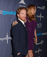Seth Green, Clare Grant<br /> The first annual Geekie Awards at The Avalon Hollywood in Hollywood, CA., USA.  <br /> August 18th, 2013<br /> half length beard facial hair black suit side profile purple dress tall short married husband wife <br /> CAP/ADM/BT<br /> ©Birdie Thompson/AdMedia/Capital Pictures