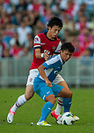 Ryo Miyaichi of Arsenal FC and Lo Kwan Yee of Kitchee in action during the pre-season Asian Tour friendly match at the Hong Kong Stadium on July 29, 2012. Photo by Victor Fraile / The Power of Sport Images