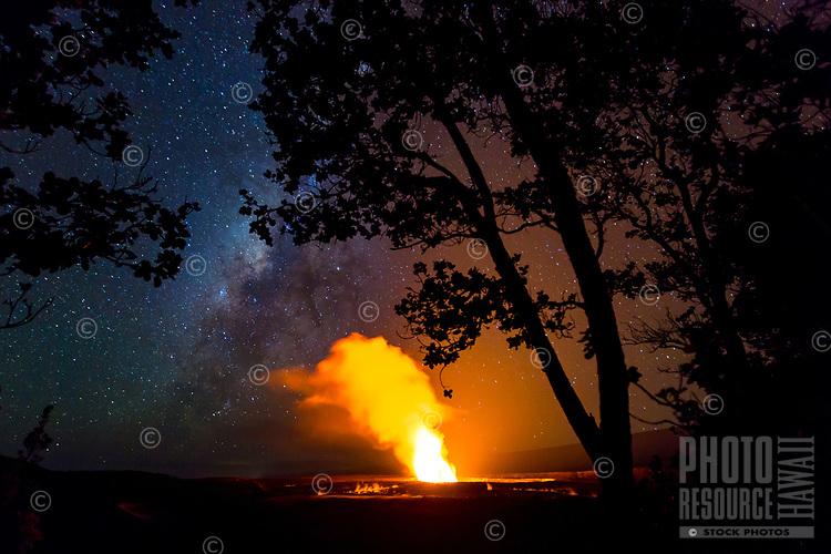 Halema'uma'u Crater under a starry sky, seen from the Kilauea Lookout near Jaggar Museum, Hawai'i Volcanoes National Park, Hawai'i Island, June 2017.