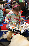 Raychel Roylance, 7, reads to Neva during a Love on A Leash event at the Carson City Library, in Carson City, Nev., on Saturday, Dec. 17, 2011. .Photo by Cathleen Allison
