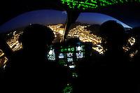 Norwegian Air Ambulance helicopter fly over Bergen by night, during a training session. <br /> <br /> Treningsøkt med instrumentflyging med<br /> GPS. PinS<br /> <br /> Bilde tatt ifm reportasje om basen i Bergen. <br /> <br /> Magasin 1/2013