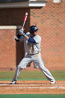 Colin Woody (22) of the UNCG Spartans at bat against the High Point Panthers at Willard Stadium on February 14, 2015 in High Point, North Carolina.  The Panthers defeated the Spartans 12-2.  (Brian Westerholt/Four Seam Images)