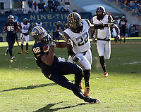 Pitt wide receiver Jon Baldwin makes a 48-yard catch while being defended by WVU defensive back Brandon Hogan (22). The WVU Mountaineers defeated the Pitt Panthers 35-10 at Heinz Field, Pittsburgh, Pennsylvania on November 26, 2010.