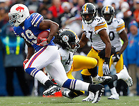 ORCHARD PARK, NY - NOVEMBER 28:  Donald Jones #19 of the Buffalo Bills runs through an attempted tackle by Troy Polamalu #43 of the Pittsburgh Steelers during the game on November 28, 2010 at Ralph Wilson Stadium in Orchard Park, New York.  (Photo by Jared Wickerham/Getty Images)