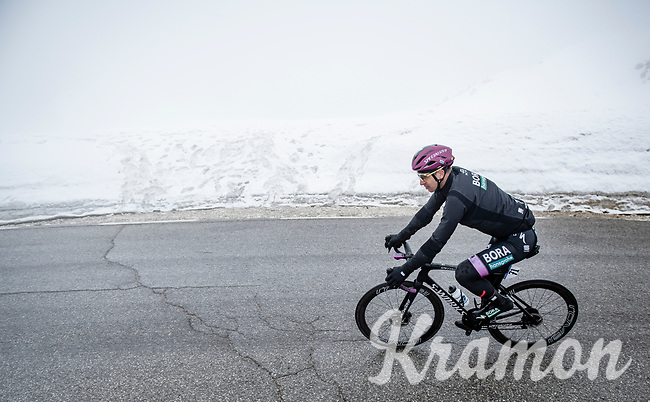 Maglia Ciclamino / Points Leader Peter Sagan (SVK/BORA - hansgrohe) coming over the Passo Giau<br /> <br /> due to the bad weather conditions the stage was shortened (on the raceday) to 153km and the Passo Giau became this years Cima Coppi (highest point of the Giro).<br /> <br /> 104th Giro d'Italia 2021 (2.UWT)<br /> Stage 16 from Sacile to Cortina d'Ampezzo (shortened from 212km to 153km)<br /> <br /> ©kramon