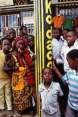 Tabora, Tanzania. Group of people outside a photographic shop.