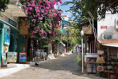Turkey, Province Antalya, Kas: Bougainvillea lined street with Greek houses   Tuerkei, Provinz Antalya, Kas: Altstadt mit unter Denkmalschutz stehenden Griechischen Haeusern, Bougainvillea