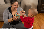 18 month old toddler boy with mother shown how new toy works