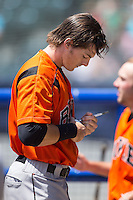 Mike Yastrzemski (4) of the Bowie Baysox autographs a baseball prior to the game against the Richmond Flying Squirrels at The Diamond on May 25, 2015 in Richmond, Virginia.  The Flying Squirrels defeated the Baysox 6-1. (Brian Westerholt/Four Seam Images)