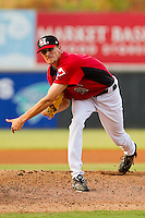 Starting pitcher Will Lamb #11 of the Hickory Crawdads follows through on his delivery against the Greenville Drive at L.P. Frans Stadium on September 3, 2011 in Hickory, North Carolina.  The Crawdads defeated the Drive 3-0.  (Brian Westerholt / Four Seam Images)