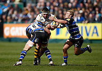 Photo: Richard Lane/Richard Lane Photography. Bath Rugby v London Wasps. Aviva Premiership. 21/04/2012. Wasps' Ben Broster is tackled by Bath's Josh Ovens  and Michael Claassens.