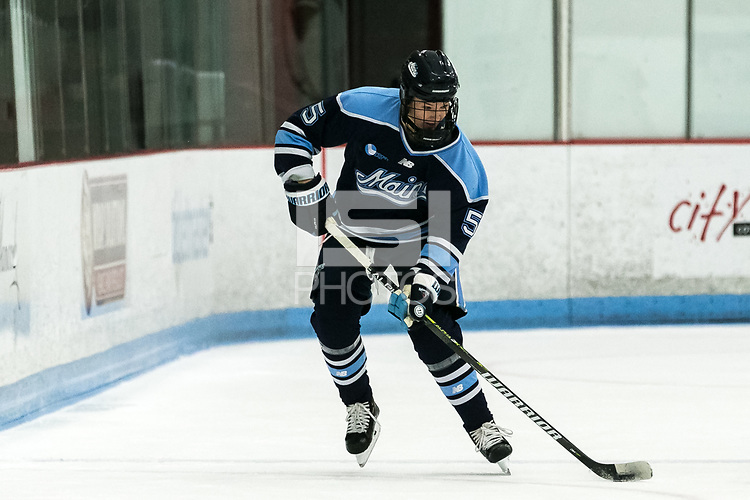 BOSTON, MA - JANUARY 04: Ebba Strandberg #5 of University of Maine passes the puck during a game between University of Maine and Boston University at Walter Brown Arena on January 04, 2020 in Boston, Massachusetts.