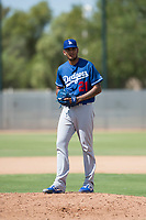Los Angeles Dodgers relief pitcher Aldry Acosta (21) gets ready to deliver a pitch during an Instructional League game against the Milwaukee Brewers at Maryvale Baseball Park on September 24, 2018 in Phoenix, Arizona. (Zachary Lucy/Four Seam Images)