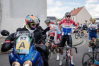 Mathieu Van Der Poel (NED/Correndon-Circus) straightening himself out while the Racing at Dwars door Vlaanderen was temporarily neutralized as the men's and women's fields came too close to each other on their journeys to Waregem. <br /> But chaos erupted as some riders stopped while others kept moving forward and a funny yet strange cat&mouse game between riders & UCI commissaires began...<br /> <br /> 74th Dwars door Vlaanderen 2019 (1.UWT)<br /> One day race from Roeselare to Waregem (BEL/183km)<br /> <br /> ©kramon