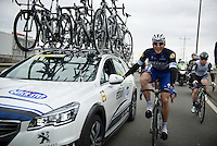 Marcel Kittel (DEU/Etixx-Quickstep) early in the race chatting to DS Wilfried Peeters while Mark Cavendish (GBR/Etixx-QuickStep) passes through<br /> <br /> 104th Scheldeprijs 2016