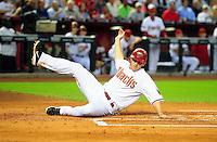 Apr. 12, 2011; Phoenix, AZ, USA; Arizona Diamondbacks base runner Stephen Drew slides safely into home in the first inning against the St. Louis Cardinals at Chase Field. Mandatory Credit: Mark J. Rebilas-