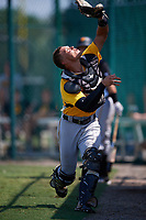 Pittsburgh Pirates catcher Dean Stafford (61) catches a popup in foul territory during an Instructional League intrasquad black and gold game on September 28, 2017 at Pirate City in Bradenton, Florida.  (Mike Janes/Four Seam Images)