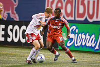 Toronto FC midfielder Rohan Ricketts (10) and New York Red Bulls defender Chris Leitch (33). Toronto FC defeated the New York Red Bulls 3-1 during a Major League Soccer match at Giants Stadium in East Rutherford, NJ, on October 04, 2008. Photo by Howard C. Smith/isiphotos.com