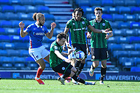 Marcus Harness of Portsmouth left and Ollie Rathbone of Rochdale vie for the ball during Portsmouth vs Rochdale, Sky Bet EFL League 1 Football at Fratton Park on 2nd April 2021