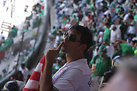 United States Men's National team fan Rishi Segal motions for Mexican fans to be silent before the start of the game at Azteca stadium. The United States Men's National Team played Mexico in a CONCACAF World Cup Qualifier match at Azteca Stadium in, Mexico City, Mexico on Wednesday, August 12, 2009.